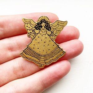 Vintage brassy gold maiden angel lapel pin